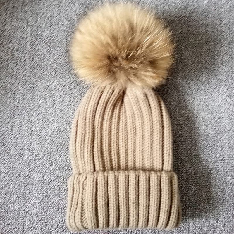 knitted hat with fur pompom