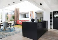Penthouse Decorated In Eclectic Style With A Black Kitchen