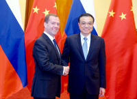 China, Russia Sign Over 30 Deals During Medvedev Visit