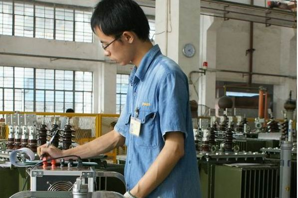 worker doing record in workshop