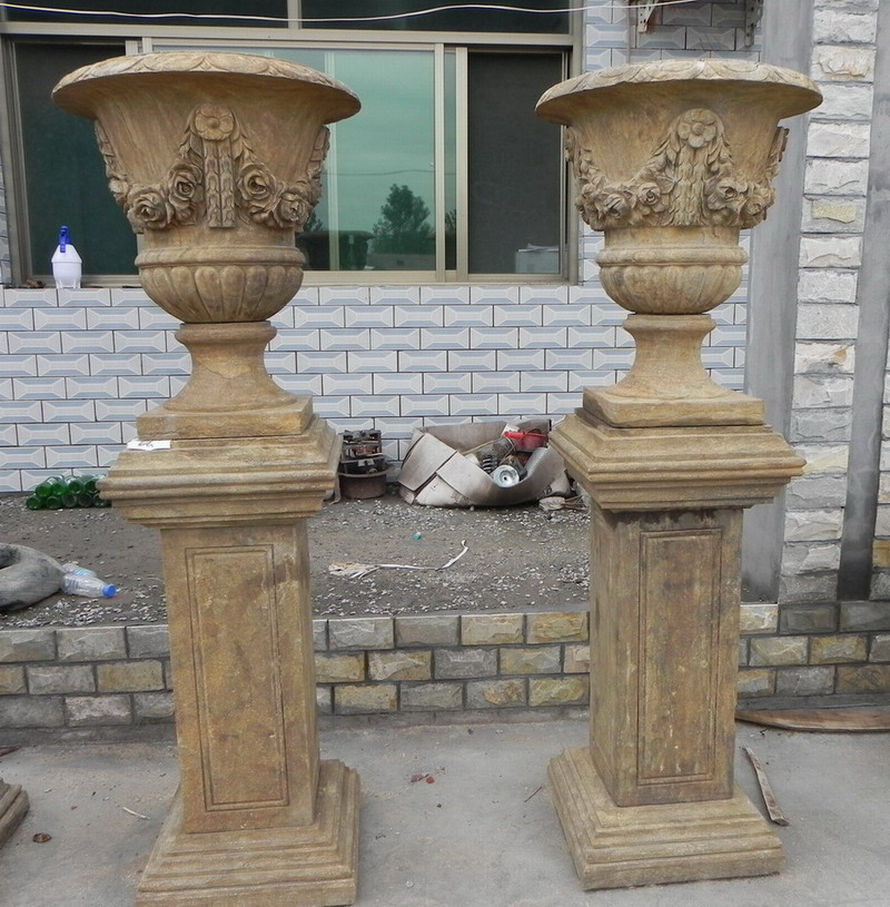 antique stone urn on base