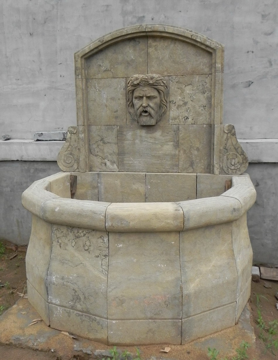 antique stone wall fountain