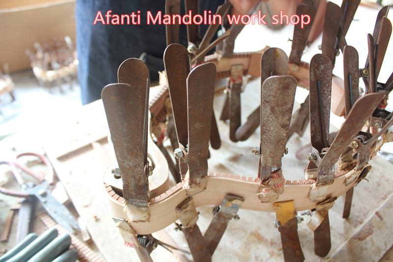 unfinished mandolin in workshop