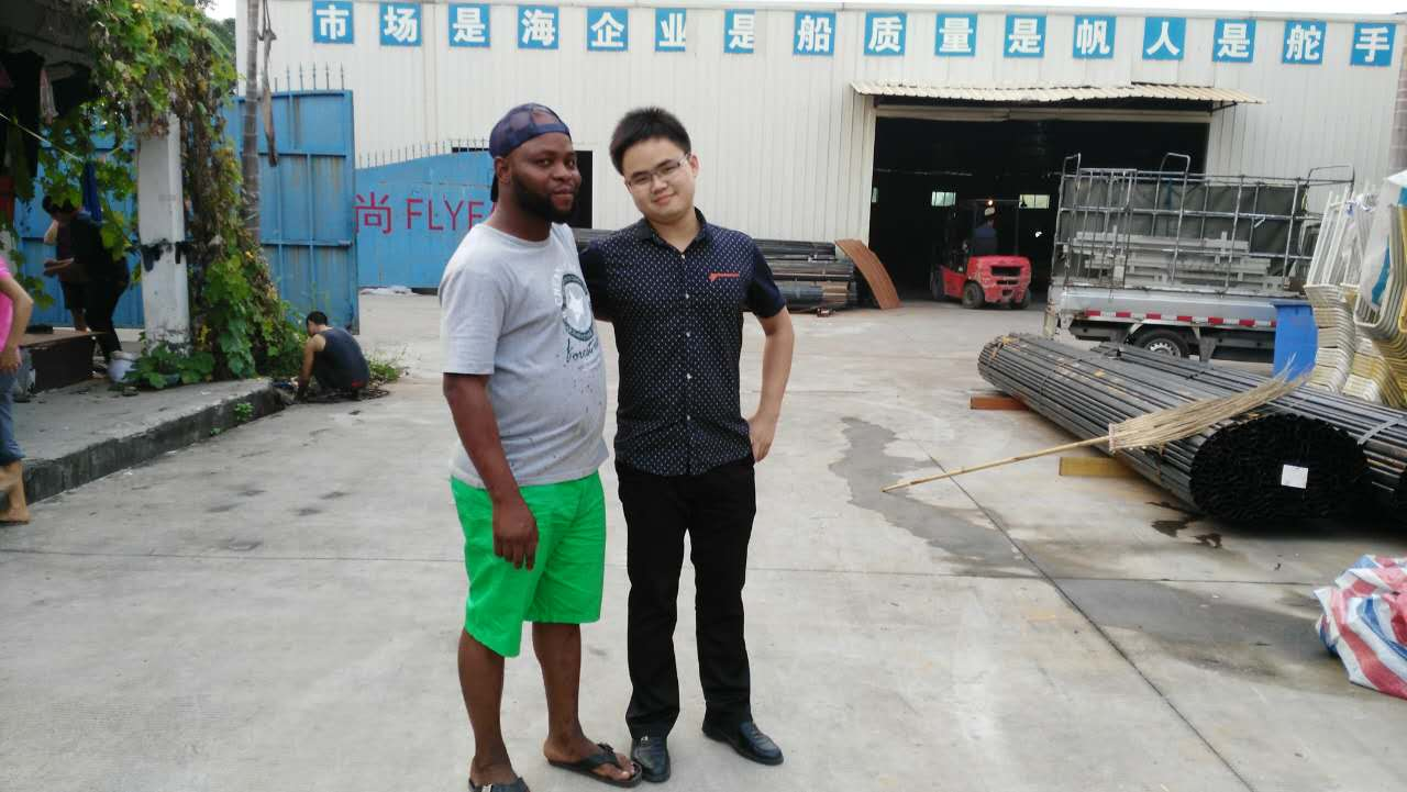 Henter with his Nigeria customer, who palced an order of 1million RMB