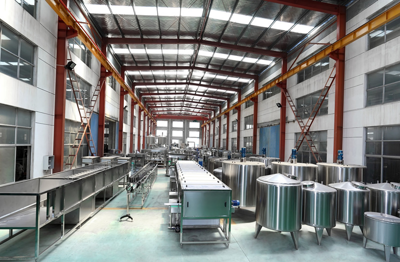 factory overview for different water treatment tanks and juice production machine