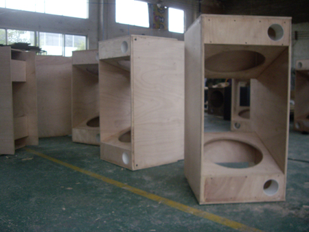 Subwoofer cabinet waiting for polish and painting in workshop