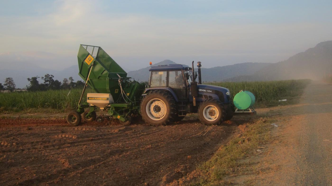 Tractor In Field Planting : Lovol tractor is planting sugarcane in a field