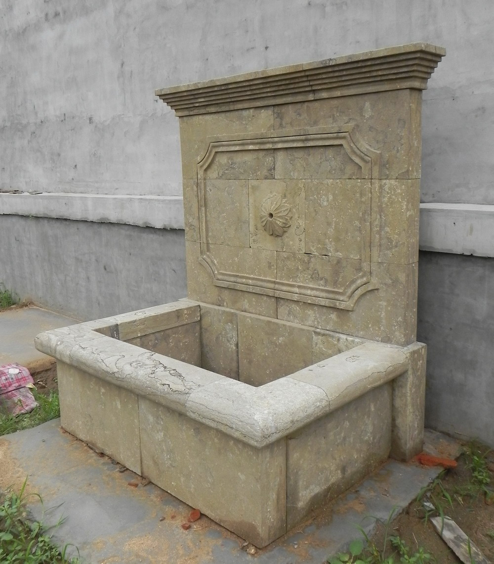 antique stone wall fountain