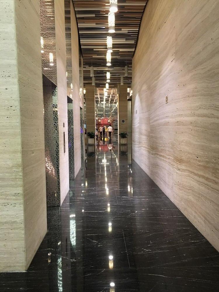 Via Lactea Black Granite Floor & Travertine Noche Wall Hotel Project