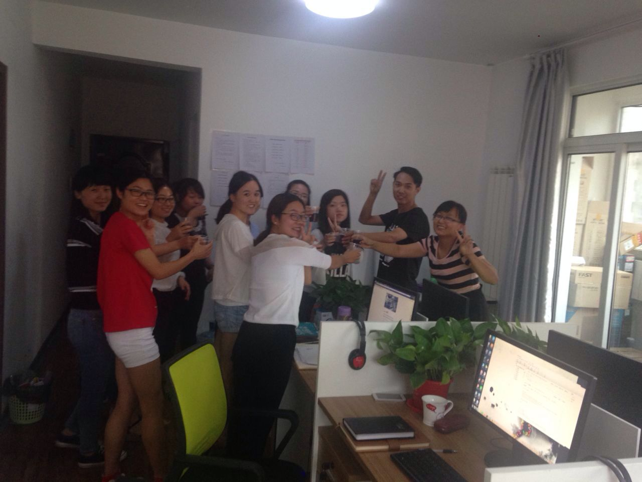 12 colleagues with Red Wine