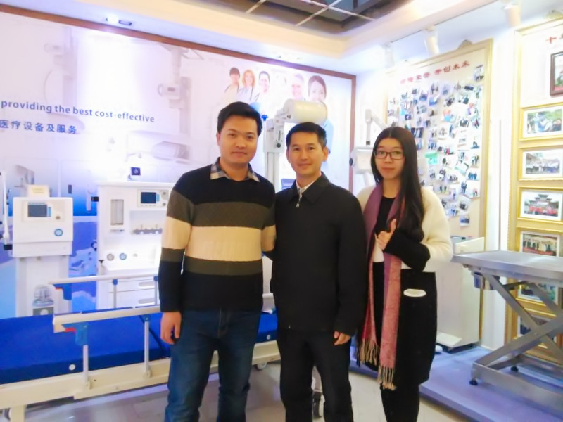 Paula and Andy with Brunei customer on x-ray lead sheet