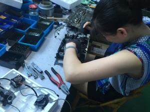 Staff Working on Knitting Machine Accessories