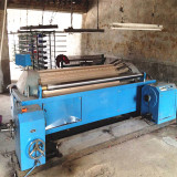 Low-speed sectional warping machine