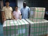 South Sudanese customer inspecting goods in our warehouse