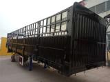 Stake type semi-trailer