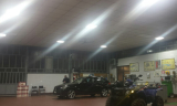 Induction ceiling light for an auto-workshop in Italy