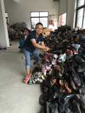Boss Checking The Used Shoes