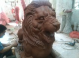 Sandstone carving lion statue