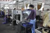 worker works on machine