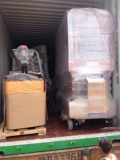 Material Handling Equipments Loaded into Container