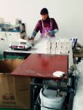 Worker is producing facial tissue