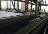 Synthetic turf back coating processing