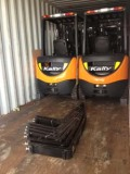 Kally forklifts loaded into Container