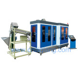 Fully automatic blow molding machine for bottles with handle