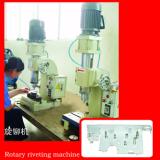 Rotary riveting machine