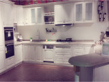 Baked white painting with golden line kitchen cabinet