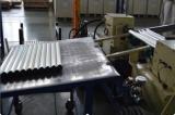 Semi-automatic roller assembling