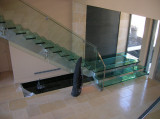spider for stair system residential glass treads and railing project in Canada