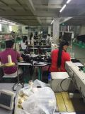 Workers Sewing the strap
