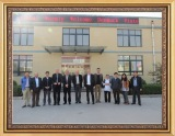 a group photo of our clients in our factory