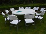 Table and chairs for event tent