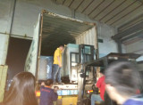 Our team loading the generator to container to shipping to our clients oversea