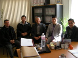 Visiting our customers with engineer in customer′s office