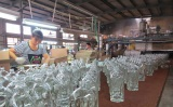 Packing of Glass Bottle in Workshop