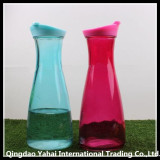 colored glass juice bottle with plastic lid
