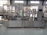 Monobloc spray filling, spray pump plugging and capping machine