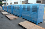Packaged air cooled water chiller with plywood box before delivery