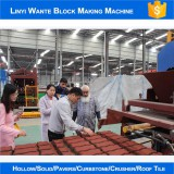 Oman customer checking our paver block machine in our factory