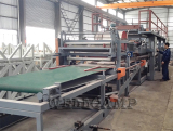 Sandwich panel production machine