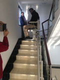 clients test stair lift in our factory