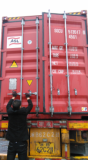 A stuff was closing the door of the container