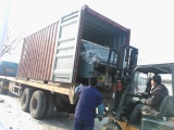 Loading Machine into Container