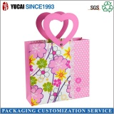 Pink paper shopping bag with handle for women