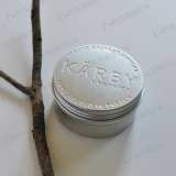 Aluminum jar with debossed logo