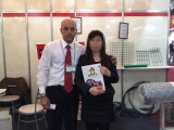 Customers take photos with sales manager