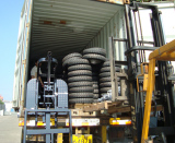 loading tricycles into containers